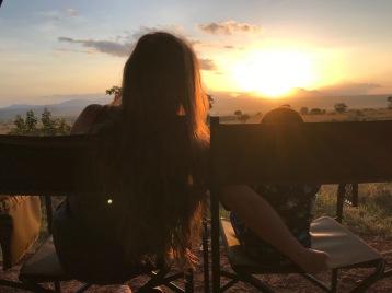 Watching the sunrise in Northern Uganda over the savannah.